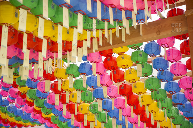 Vibrant paper lanterns hanging in Buddhist temple