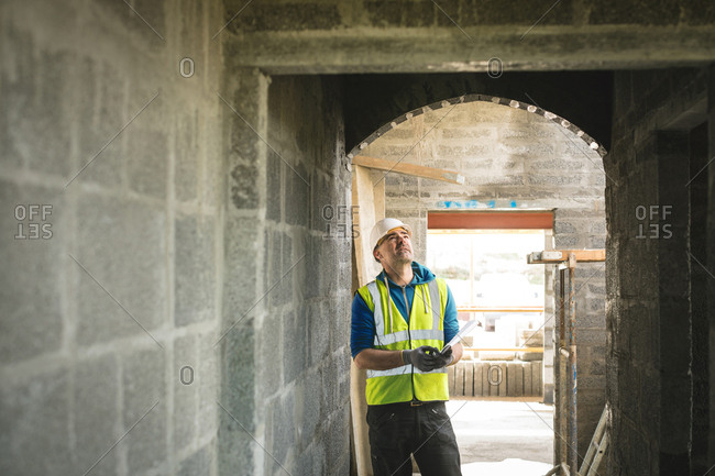 Engineer looking at the doorway at construction site