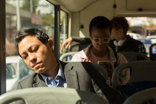 Man sleeping peacefully while travelling in the bus