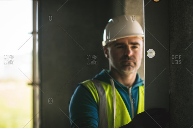 Close-up of engineer doing a level check on the wall at construction site