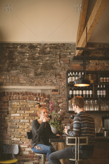 Young couple having coffee at bar counter
