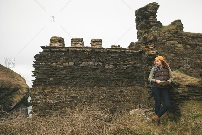 Beautiful female hiker with map looking sideways