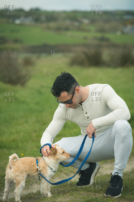 Affectionate man petting his dog