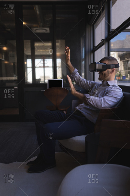 Businessman using virtual reality headset at office