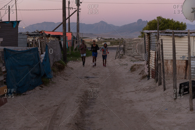 Young male boxers jogging at dawn