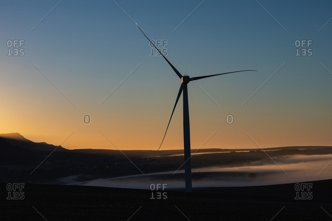 Wind mill at a wind farm during dusk