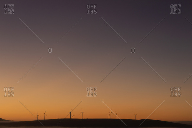 Wind mills at a wind farm during dusk