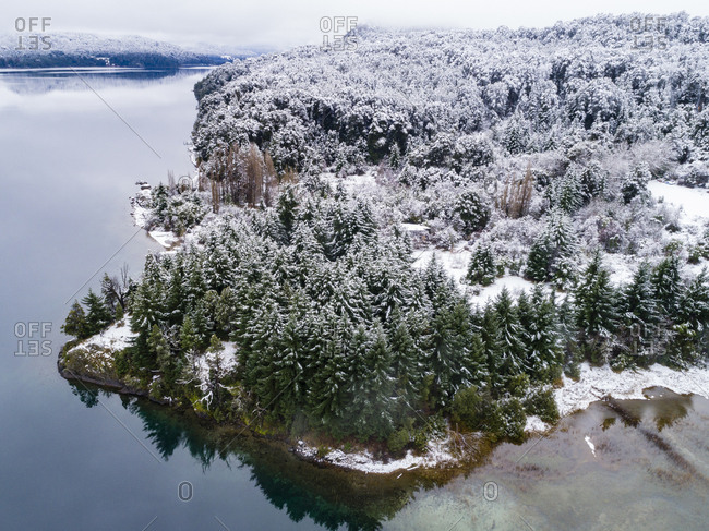 Snow covered forest and lake in rural Bariloche, Argentina