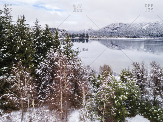 Trees surrounding lake in winter in Bariloche, Argentina