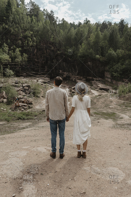 Could holding hands from behind in rural field