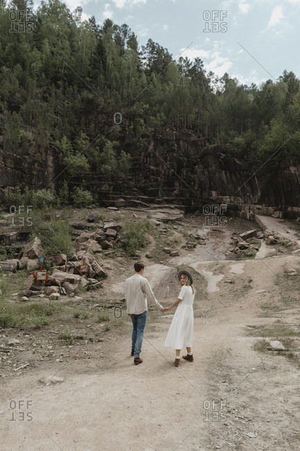 Couple walking towards a forest