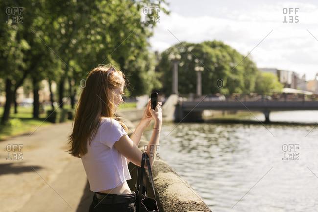 Teen taking selfie by river, Minsk, Belarus