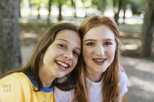 Portrait of two teens with freckles at a park, Minsk, Belarus