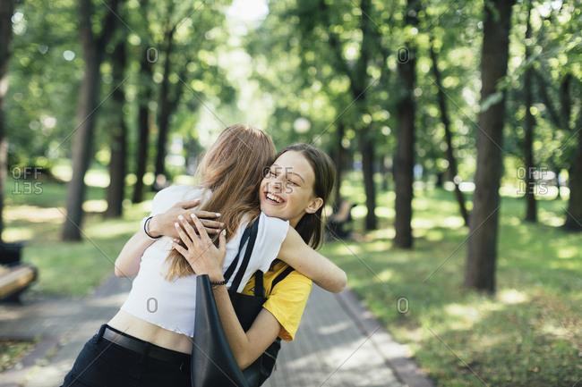 Teens hugging at a park, Minsk, Belarus