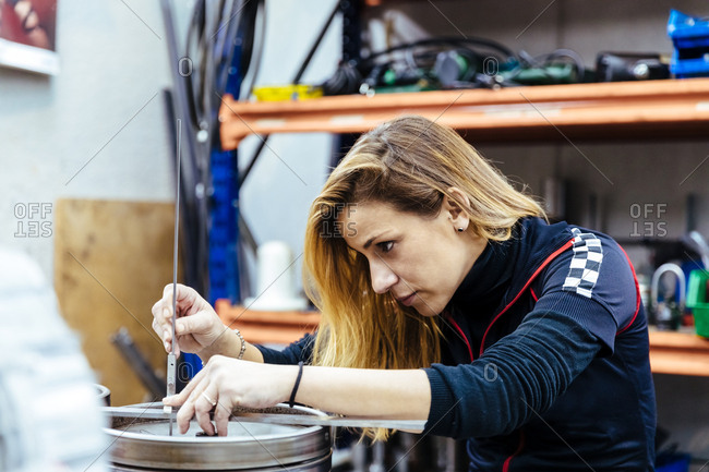 Woman working in a mechanical workshop