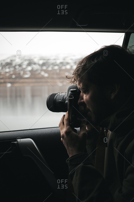 Photographer taking shots from car