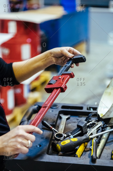 Woman with tools in a mechanical garage