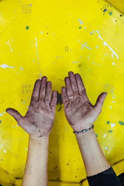 Hands stained with grease in a mechanical workshop