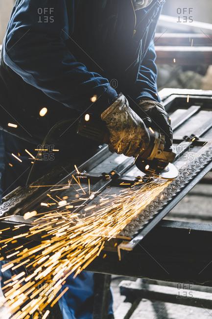 Man works with grinder machine