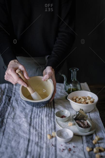 Crop woman preparing sauce