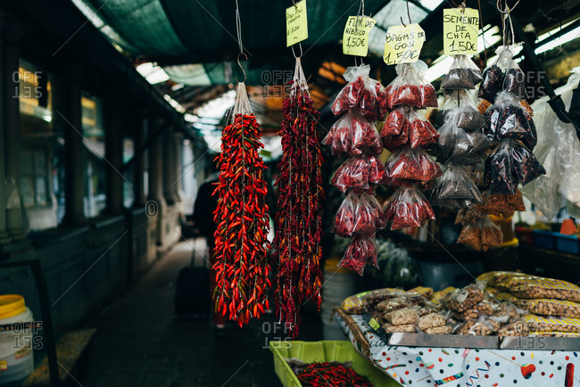 Different spices hanging and laying on counter in the market