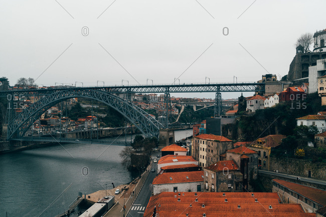View to river in the channel and old European city with orange roofs