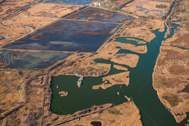 Picturesque aerial view of water flooding dry marsh in countryside