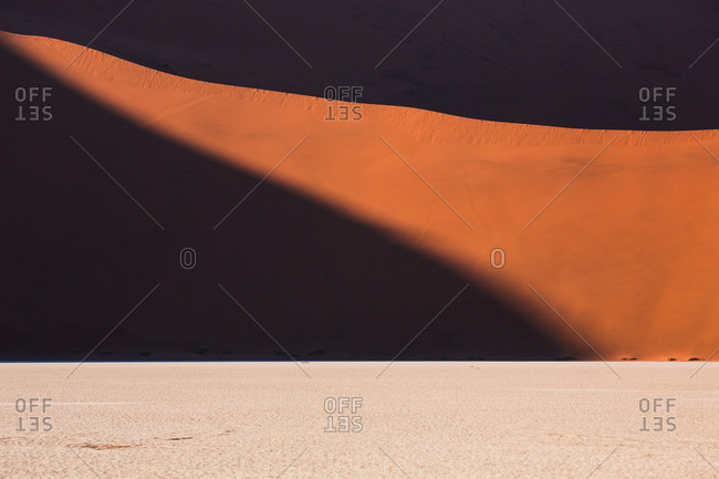 Picturesque view of sand and hill in desolate desert