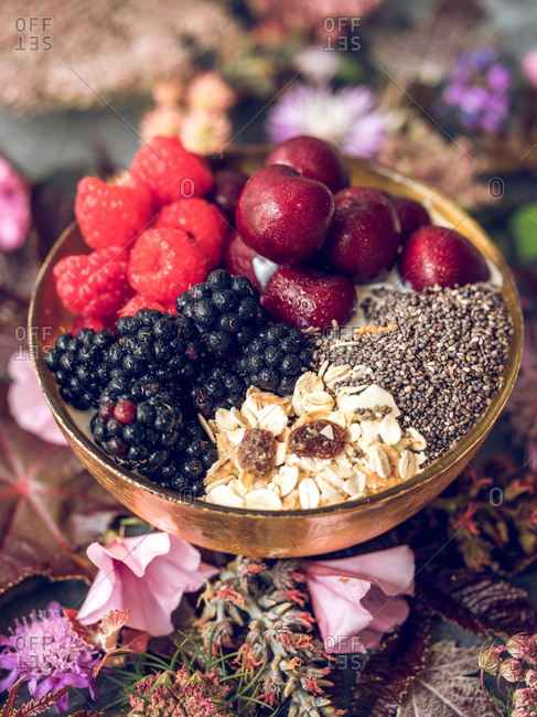Tasty breakfast with fruits in bowl