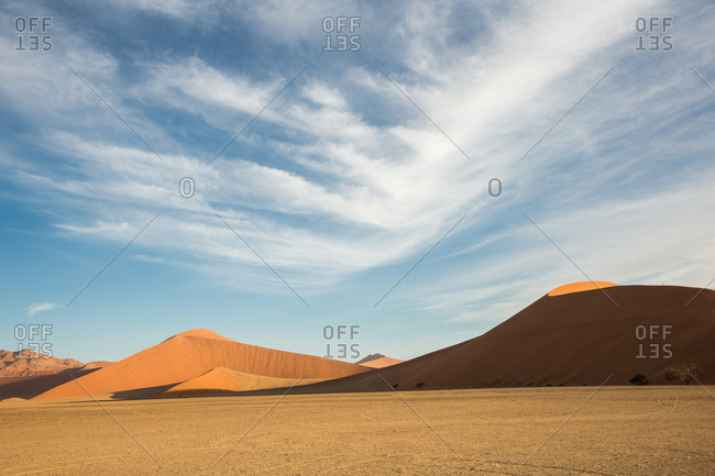 Picturesque view of thin clouds floating over beautiful desert