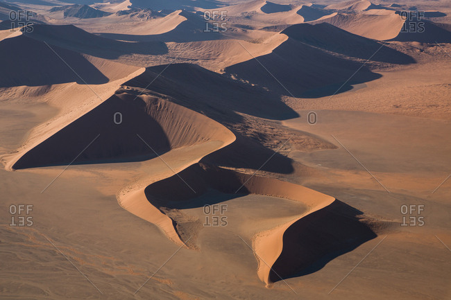 Aerial view of huge dunes in beautiful sandy desert