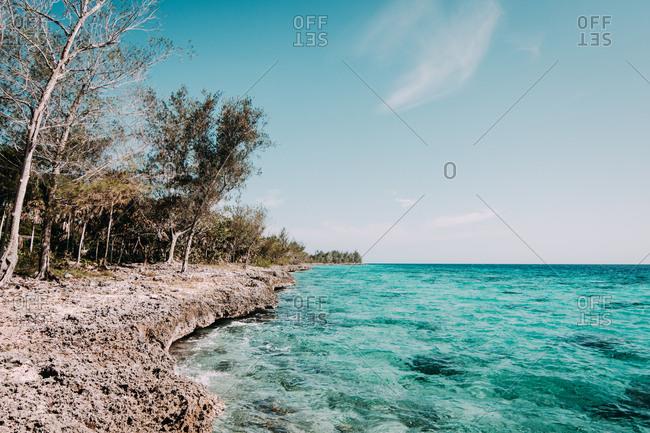 Turquoise water washing rocky coastline