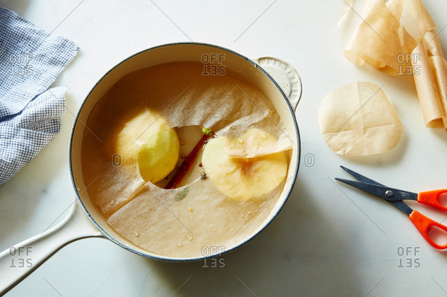 Poached fruit submerged in water