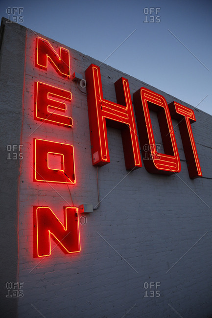 Route 66, New Mexico - June 19, 2018: Neon signs on side of building at sunset