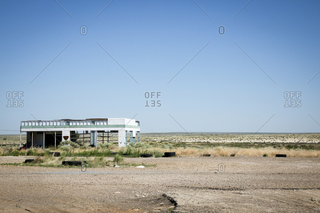 Abandoned storefront off rural desert road