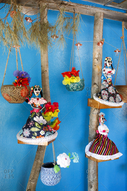 Festive sugar skull decorations hanging in vibrant setting