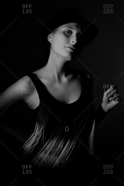 Monochrome portrait of model in dark setting