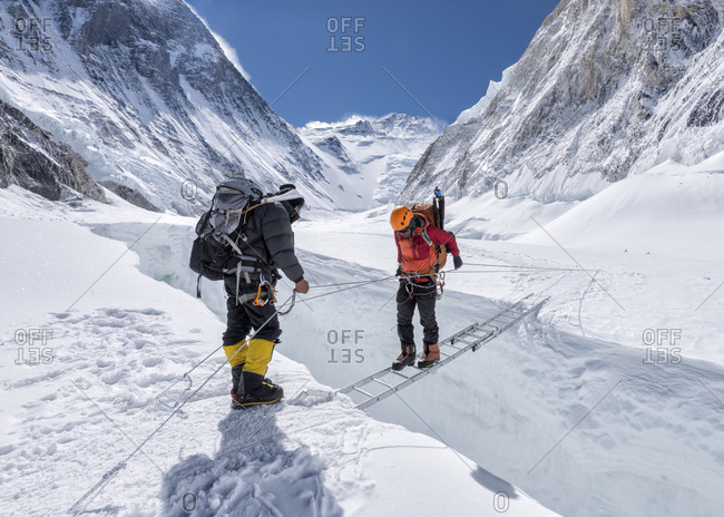 Nepal- Solo Khumbu- Everest- Sagamartha National Park- Mountaineers crossing icefall at Western Cwm