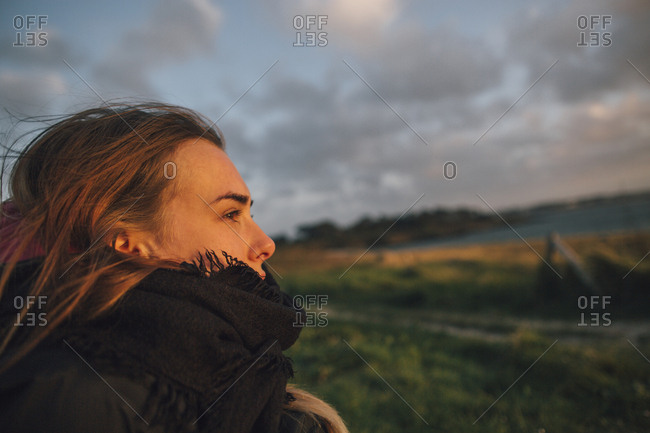France- Brittany- Landeda- woman in rural landscape at dusk