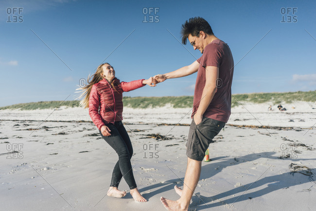 France- Brittany- Landeda- couple having fun on the beach