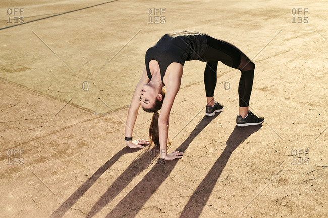 Sportive woman doing yoga- bridge position