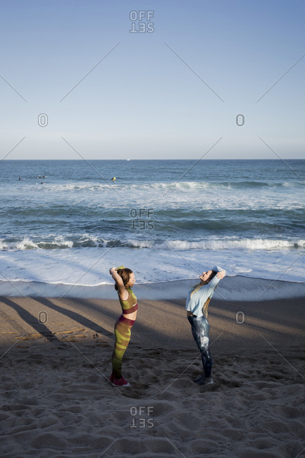 Women during workout on the beach