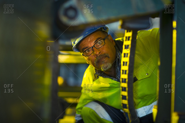 Engineer in industrial plant inspecting machines