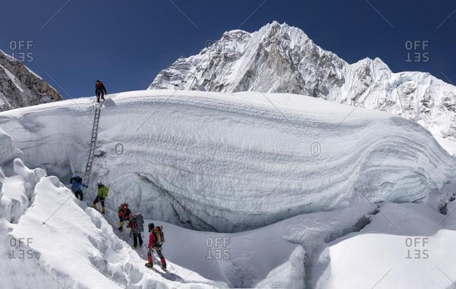 Nepal- Solo Khumbu- Everest- Sagamartha National Park- Mountaineers climbing icefall