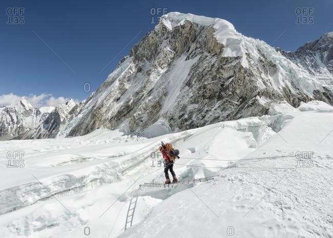 Nepal- Solo Khumbu- Everest- Sagamartha National Park- Mountaineer crossing icefall at Western Cwm