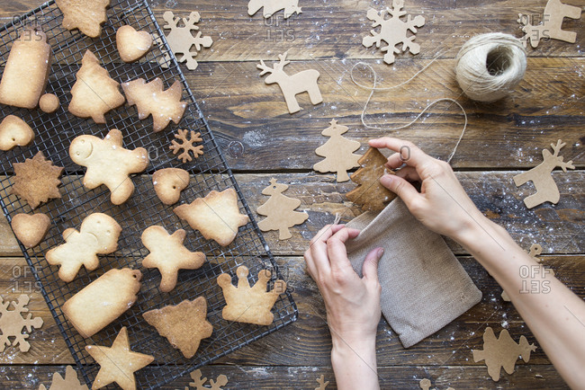 Woman\'s hands packing homemade Christmas cookies into sachet