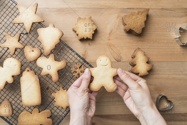 Woman's hands holding Gingerbread man