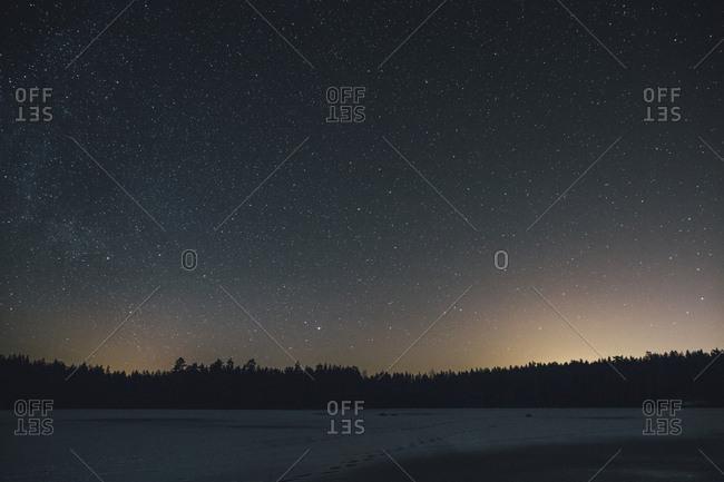 Sweden- Sodermanland- frozen lake Navsjon in winter under starry sky at night