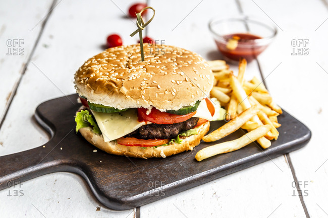 Homemade Hamburger with cheese- french fries- ketchup and tomato