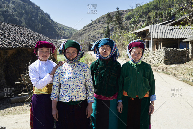 Ha Giang, Vietnam - February 16, 2018: Portrait of a group of authentic Hmong ethnic women looking at camera in mountain village.